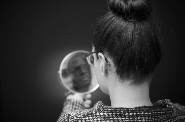 43277068 - ego businesswoman looking in the mirror and reflecting